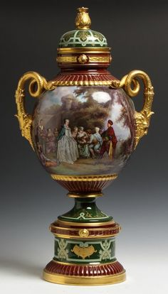 Austrian Gilded And Hand Painted Porcelain Covered Urn With Court Scenes And Snake And Masked Handles