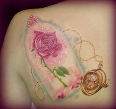 Rose from Beauty and the Beast and the time-turner from Harry Potter. How awesome is this #tattoo ? #awesome
