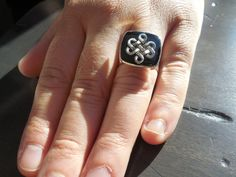 Black and sliver ring for men. Medieval look and perfect for larp. ***the last picture is there as a reference for the view from behind and does not present the actual ring. Celtic Knot Ring, Medieval Jewelry, Resin Coating, Square Rings, Larp, Class Ring, Knots, Rings For Men, Hand Painted