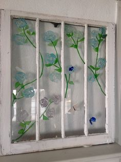 old window with sea glass roses and butterflies