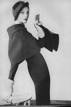 Anne Saint-Marie, 1959 Vogue, Suit: Gaines-Parnet, tilted bowler of black velvet: Lilly Daché. Photo: Henry Clarke