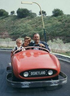 walt, daughter diane and grandson christopher have fun in disneyland, 1957