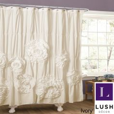 Soft brushed poly with ruching create a perfect backdrop for the grand crafted flower details that give this shower curtain the perfect look. The curtain gives the bathroom that special look you were hoping for.