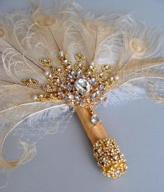 Gold Glamour Brooch Bridal alternative Ostrich Feather Fan Bridal Bouquet Ivory Champagne Great Gatsby Bouquet The gorgeous vintage inspired feather fan can be a great alternative feather bouquet ! A Great accessory for the Bride or Bridesmaids ar fo Feather Bouquet, Wedding Brooch Bouquets, Bridesmaid Bouquet, Bridal Jewelry Vintage, Crystal Bouquet, Art Deco Wedding, Blush Bridal, Bridal Accessories, Floral Design