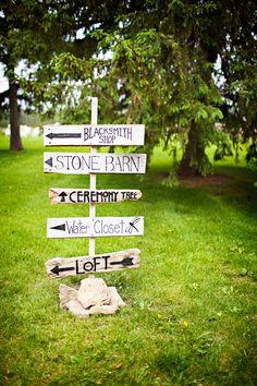 white and black wood directional arrow wedding sign | mayowood stone barn coountry wedding | photo: angelicjewelphotography.com