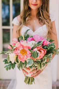 pink peony bouquet - photo by Lillywhite Photography http://ruffledblog.com/wearing-her-sisters-wedding-dress