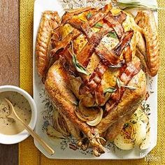 This Bacon Wrapped Turkey recipe is a delicious, crowd-pleasing centerpiece for your Thanksgiving meal. Drizzle each serving with Bacon and Onion Gravy that's accented with a pinch of fresh sage. Thanksgiving Feast, Thanksgiving Side Dishes, Thanksgiving Recipes, Holiday Recipes, Keto Holiday, Hosting Thanksgiving, Holiday Meals, Roasted Turkey, Smoked Turkey