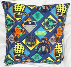 Daleks, Cybermen, and Tardis, Oh My! 14 inch pillow made of 100% cotton with a zipper on the bottom for easy washing.