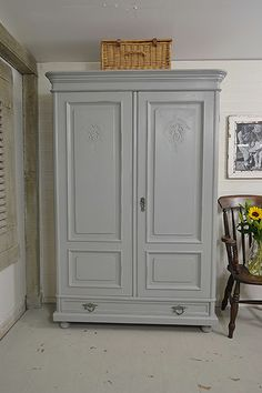 This stunning Dutch wardrobe will be the centerpiece of any bedroom! With it's charming curves, ample storage and pretty handles, we simply adore it! We've painted in Farrow and Ball Manor House Grey with Lamp Room Grey inside. The handles have a natural patina which we adore. https://www.thetreasuretrove.co.uk/bedroom-storage/large-dutch-shabby-chic-rustic-wardrobe #shabbychic #antiquefurniture #farrowandball