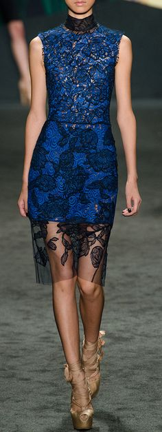 Adore the colour and the black lace widening as it flows down the dress.