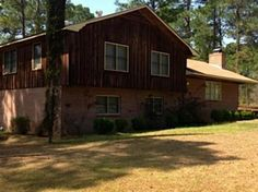 Reduced! This beautiful split level home has been remodeled with new carpet paint and tile countertops in kitchen. The front door opens to the formal living room with fireplace hearth with wood stove to keep the home warm. Just off of the formal living room is the dining room with parquet flooring. The dining room leads into the kitchen that overlooks the backyard and the screened in porch area that you can use to enjoy any time of the day and night.