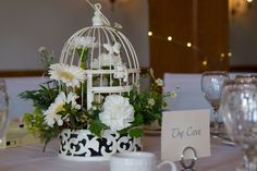Center pieces - birdcage, spring flowers.