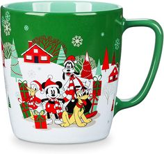 You will be fa la la-ing in love with each sip you take from this Mickey and friends mug. Featuring colorful character artwork of Mickey, Minnie, Goofy, Donald and Pluto with happy holiday motifs, this mug is a cozy cup of cheer! Mickey Mouse Club, Mickey Mouse And Friends, Disney Mickey Mouse, Disney Tassen, Disney Store Mugs, Resort Logo, Disney Cups, Minnie Bow, Dog Pajamas