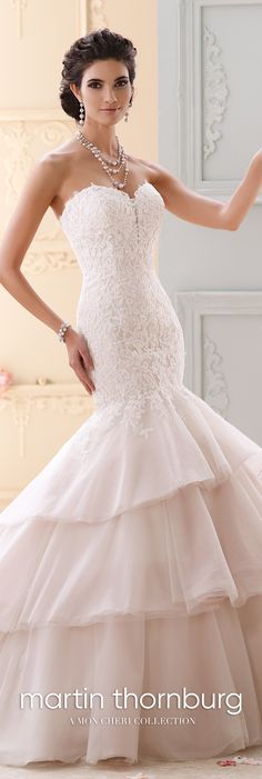 This strapless tulle, and lace trumpet dress features a sweetheart neckline with a deep illusion modesty piece, and a exaggerated dropped waistline. Mon Cheri Wedding Dresses, Bridal Wedding Dresses, Designer Wedding Dresses, Bridal Style, Bridesmaid Dresses, Wedding Outfits, David Tutera, Tan Wedding, Wedding Stuff