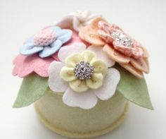 This Pretty Posy Pincushion is an easy sewing project that will bring a smile to your face every time you sit down at your sewing machine. Even if it's frigid outside, the adorable flower pattern is sure to add some warmth to your craft room.