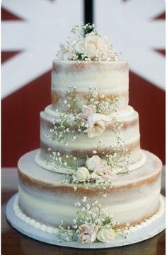 Elegant Wedding Cake With A Little Froth And Flowers Pinned By High Billinghurst Farm Wedding Venue