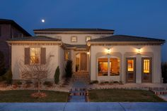 Montecito This traditional Mediterranean style home features stucco, brick and wrought iron detailing to add to its charm.