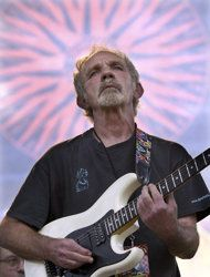 """FILE - In this June 5, 2004 file photo, singer-songwriter J.J. Cale plays during the Eric Clapton Crossroads Guitar Festival in Dallas, Texas. Cale, whose best-known songs became hits for Eric Clapton with """"After Midnight"""" and Lynyrd Skynyrd with """"Call Me the Breeze,"""" has died. He was 74. Cale's manager Mike Kappus said the architect of the Tulsa Sound died Friday, July 26, 2013 of a heart attack at Scripps Hospital in La Jolla, Calif. (AP Photo/Tony Gutierrez, File)"""