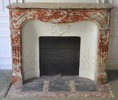 Antique Regence style fireplace in Red from the Languedoc marble with its cast iron insert