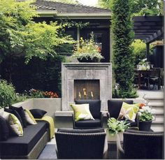 Concrete framed outdoor fireplace has dramatic, modern impact on this patio area! Create a stunning patio and backyard with these creative outdoor spaces and design ideas that will surely inspire you. Outside Living, Outdoor Living Areas, Outdoor Rooms, Outdoor Furniture Sets, Outdoor Decor, Outdoor Seating, Living Spaces, Outdoor Dining, Outdoor Sofa