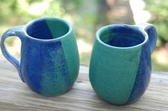 Green and blue pottery mugs, $ 40