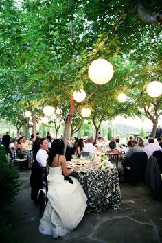 outdoor summer reception under trees with lighting