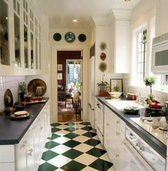 Small Kitchen Designs Several of these Galley Kitchen Designs would work well in our house. We especially like this one with the green-diamond floor. - Discover gorgeous galley kitchens that use careful planning to maximize a narrow space. Galley Kitchen Design, Small Galley Kitchens, Kitchen Tiles, Kitchen Colors, Kitchen Flooring, Kitchen Countertops, New Kitchen, Cool Kitchens, Kitchen Dining