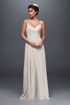 "A simple, airy lace wedding dress, beautifully pleated at the sweetheart bodice before flowing into a floor-skimming skirt.   Galina, exclusively at David's Bridal  4"" extra length wedding dress  Polyester  Sweep train  Back zipper; fully lined  Dry clean  Imported  Also available in regular,  plus size, and plus extra length"