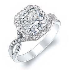 Neil Lane Cushion Cut diamond ring with twisted band.