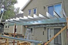 Framing Decks With Steel:  Light-gauge steel framing requires fewer footings and stays straight and flat.