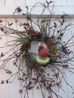 Winter Wreath, Holiday Wreath, Cardinal Winter Wreath    Holiday wreath that can last all winter long. Rustic looking cardinal with birdnest, pinecones, berries, moss, artificial cedar & leaves on a handmade twig wreath. Very simple & delicate design that is all about nature.    Wreath dimensions are: 23 -24 inches wide; 25 - 26 inches high; 5.5 inches deep.