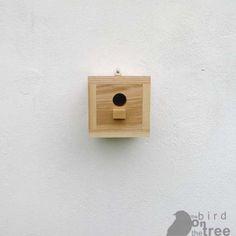 square wood birdhouse
