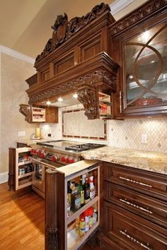 Notice the pull outs, above the range for spices, on both sides of the stove. LOVE this detail!