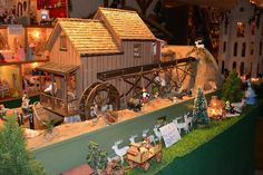 Found on EstateSales.NET: Working water mill!! Features 5 rooms with miniature dollhouse collectibles!