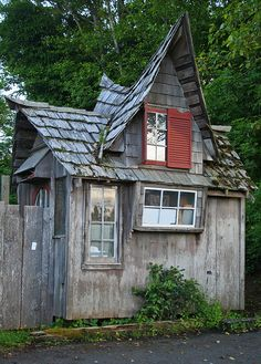 Rustic Tiny Cabin with Red Shutters