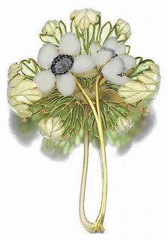 Anemones brooch by Rene Lalique, ca.1901. Two anemone stems with glass petals around blue centers, and opalescent enamel and green plique-a-jour leaves