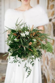 Love the smattering of white flowers amid the greens and succulents ~ we ❤ this! moncheribridals.com