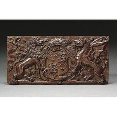 c.1525-1547: carved panel showing arms of Henry VIII supported by a lion and a gryphon