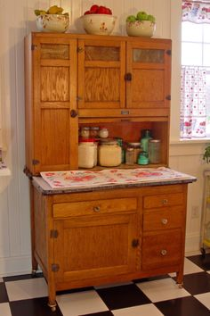 Sellers Brand Hooiser Cabinet. Love the Autumn Leaf mixing bowl, also.