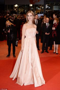 Fit for a princess: Lily looked stunning in satin pink strapless gown as she worked the cameras at the 65th annual German film festival