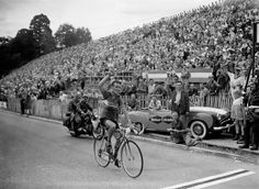 Charly Gaul of Luxembourg crosses the finish line on July 25, 1955 in Toulouse and wins the 17th stage.  ( - AFP/Getty Images)