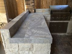 Silver travertine tile can be a unique, stylish countertop, as seen in this outdoor kitchen by Outdoor Homescapes of Houston. more at www.ou...