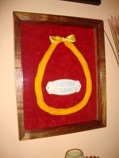 Hand made feather lea and koa wood frame.