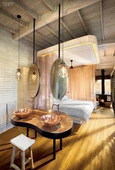 A guest bathroom at Sandibe Safari Lodge by Fox Browne Creative and Michaelis Boyd Associates. Photography by Dook.