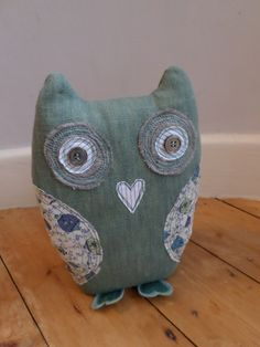 Owl made from pale green denim & vintage fabrics with ghost button eyes