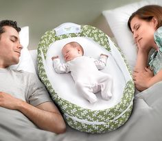 Snuggle Nest CoSleeper - has music and sounds and a light so you can change baby without turning on the lights!