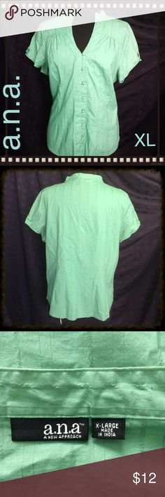Green Top / Blouse / Short Sleeves / VERY Nice! Green Blouse - Self covered buttons - Wear in or out - Slits on the sides - Fabric 89% Cotton - 9% Rayon - 2% Spandex - GOOD LOOKING! a.n.a Tops Blouses