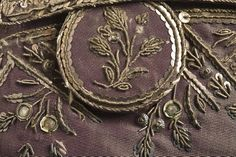 Detail button, 3-piece suit, Europe, circa 1790, altered circa 1805. Coat and breeches: purple silk plain taffeta with sequins and metallic-thread embroidery; waistcoat: pale yellow silk satin with sequins and metallic-thread embroidery.