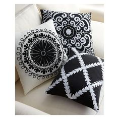 """Turkish suzani-style pillows in bold black and white are hand embroidered. Shown front to back: Samarkand, Uzbek, & Rangoli. Handcrafted of cotton with cotton embroiderypolyester fill. Dry clean. Samarkand pillow, 14"""" x 20"""". Uzbek pillow, 18""""Sq....."""