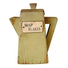 This Soap Flakes container was cleverly designed to replace a detergent box in a 30s laundry room. Styled to look like a pitcher, it is hand made of wood. It retains both its original lid plus the original yellowish paint. At 8.5 tall & 7 wide at the handle, the container didnt hold much soap but it definitely qualifies as a fun piece in todays country home.  Shipping to the US is $15. To see all our SELECTIVE SALVAGE: http://etsy.me/1HH8vIo  To see more SMALLS: http:/...